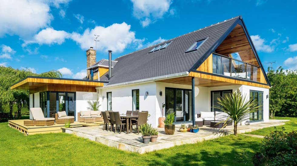 chalet style home with single storey extension