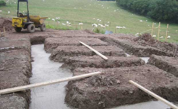 Concrete filled foundation trenches