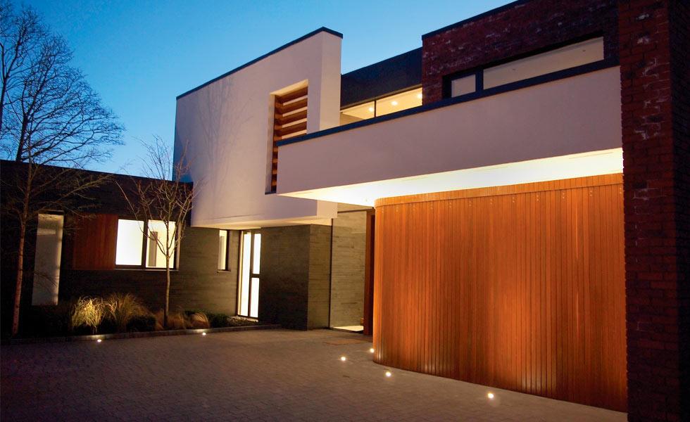 sliding curved garage door at night