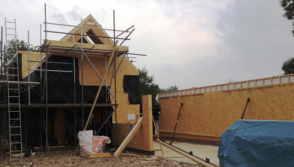 S-garage wall erected and house covered with breathable membrane