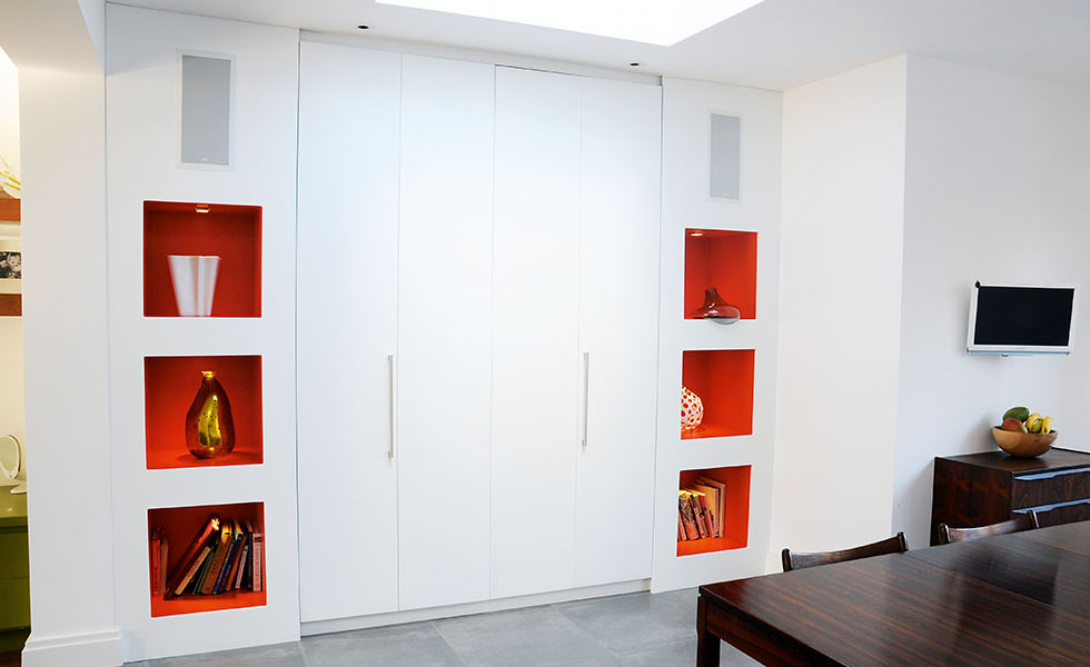Built-in storage created using an alcove in a stud wall