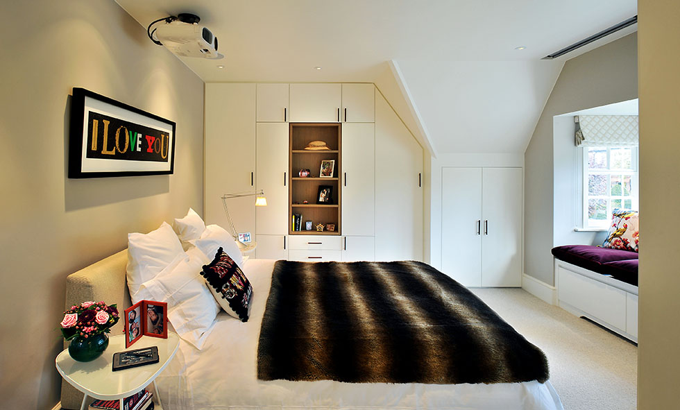 Bedroom with built-in wardrobes and storage