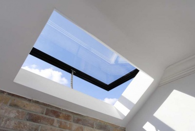reflex glass skylight black with exposed brick