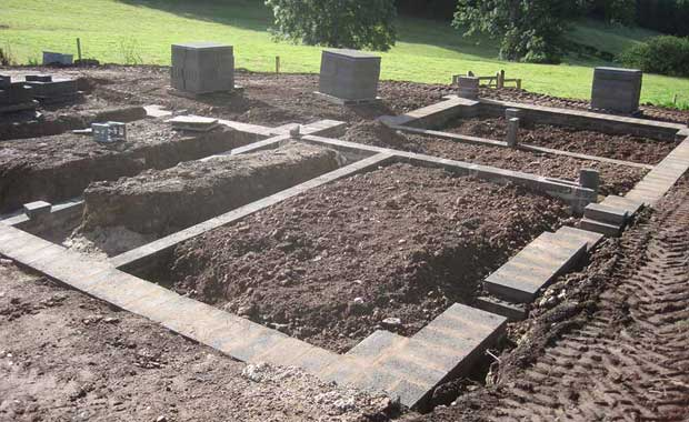 The blocks are laid. They form the base for the beams.