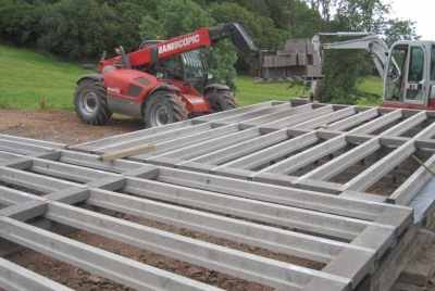 Concrete joists being laid in the foundations for an oak frame house