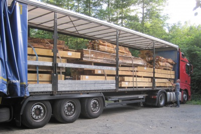 a lorry delivers an oak frame