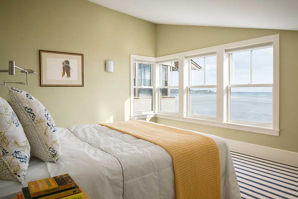 Bedroom accommodation boasting ocean views in CJAB's beach house project in Maine