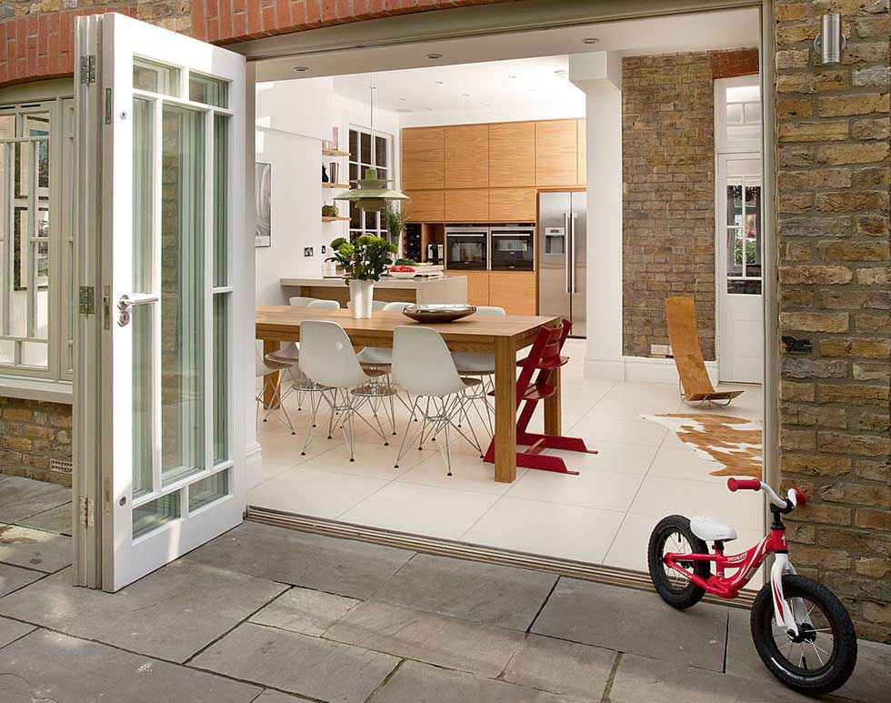 Custom-made traditional-style timber bi-fold doors