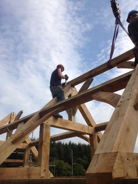 sky-behind-man-fixing-trusses