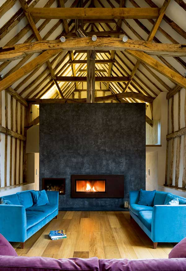 Tall fire surround in a barn conversion