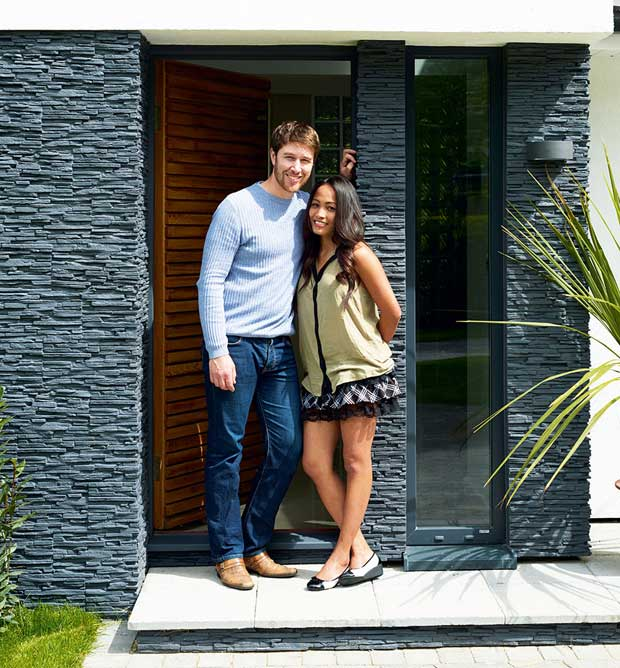 Stuart and Elmarie Ward in fron of their self build house