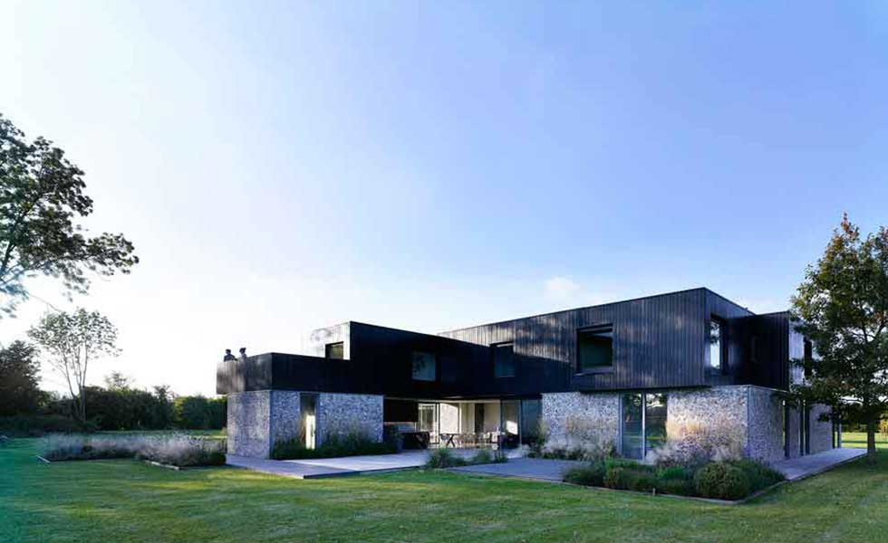 stone and timber clad home in suffolk
