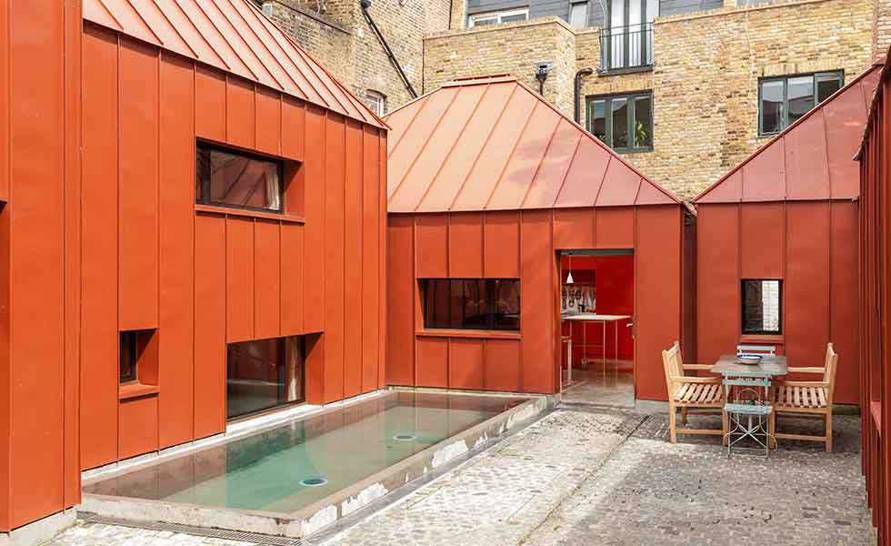 contemporary orange steel courtyard home in London