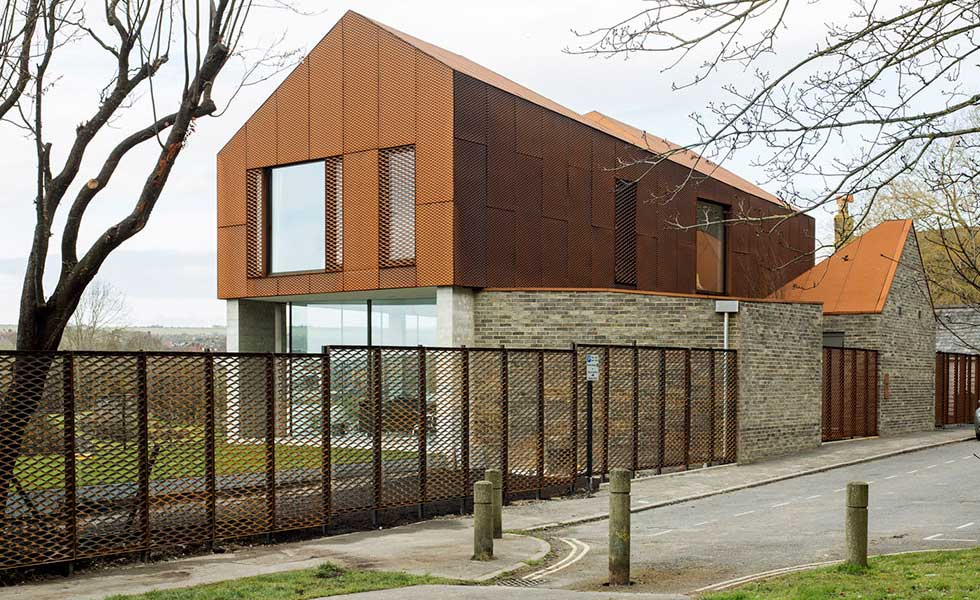 corten and steel self build by the river