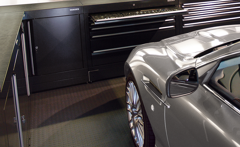 expensive car in a garage with base units and PVC floor tiles