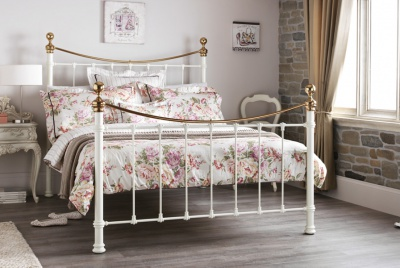 Metal frame bed with painted gold effect