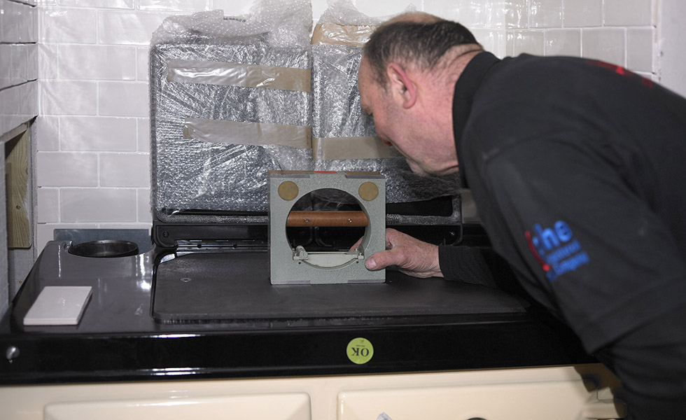 checking the level of the rayburn range cooker