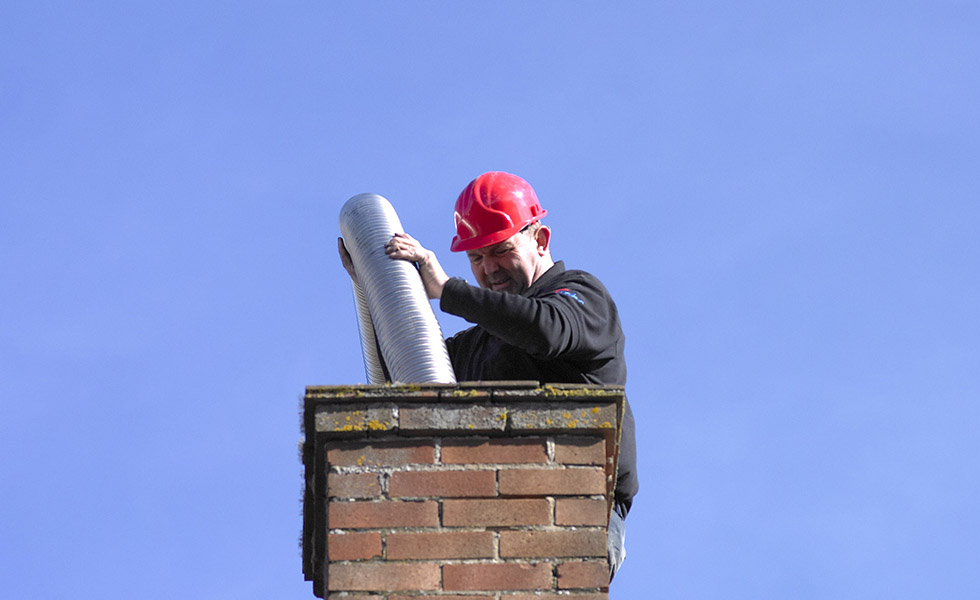 putting the metal flue in for the range cooker