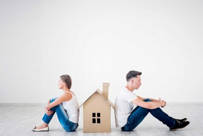 Quarrelling couple with cardboard house