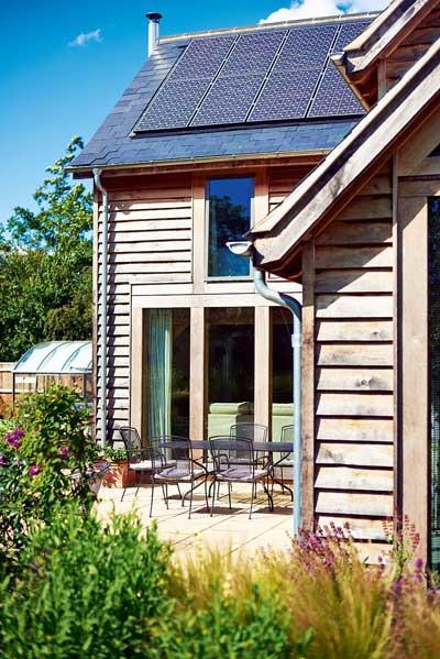 Solar panels and cedar cladding