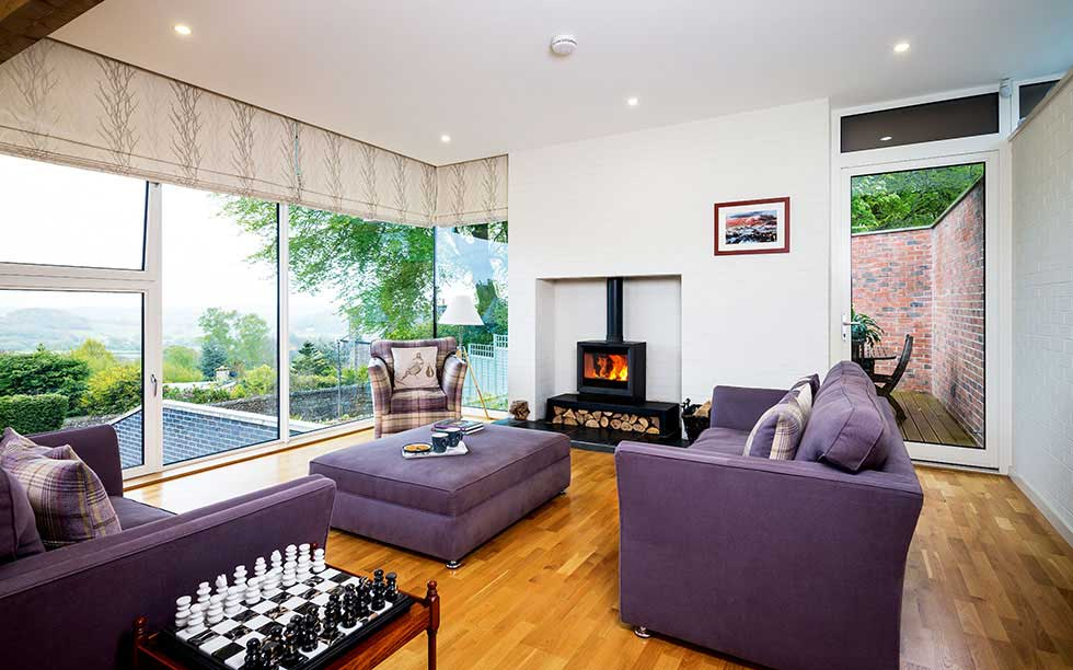 Floor-to-ceiling glazing and corner windows maximise light in the living area