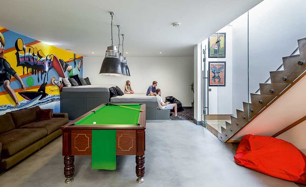 This games room within a new basement offers a great entertaining space for the family to unwind