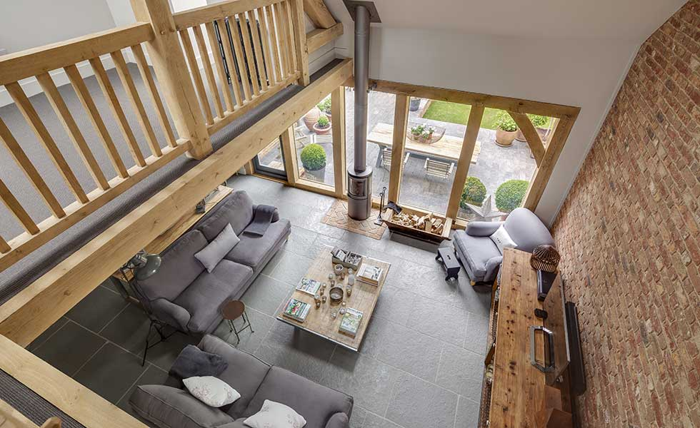 This traditional barn-style self build is perfect for entertaining thanks to the double-height sitting area off the open plan kitchen