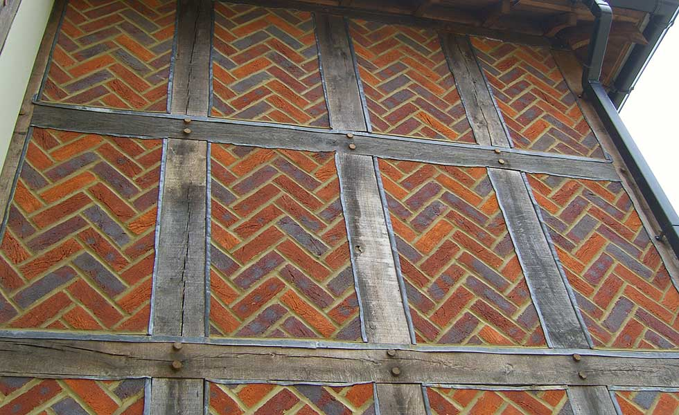 Brick and timber in traditional pattern by Bovingdon