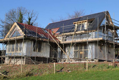 weathertight oak frame with scaffold and solar panels