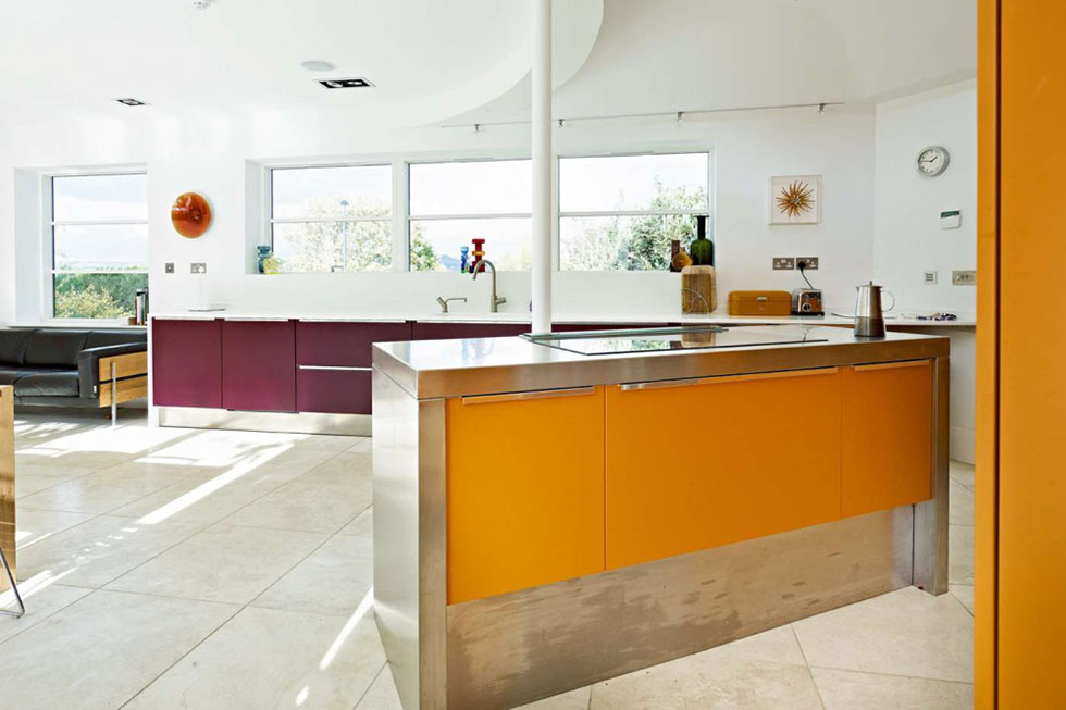 Superb The Striking Combination Of Orange And Aubergine Brings Vivid Colour To The  Open Plan Effeti Kitchen