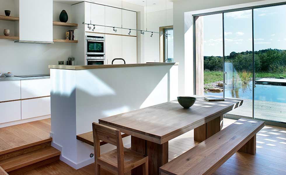 open plan kitchen with sliding doors to garden