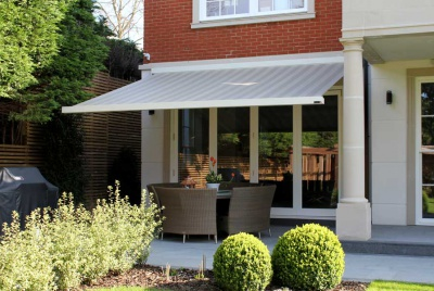 Enhance, protect and prolong the use of your terrace with a stylish motorised patio awning