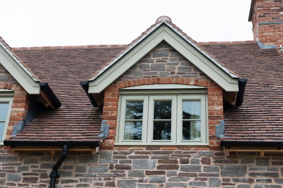 Sage windows on oak framed new buiild