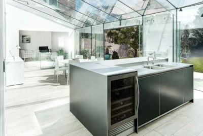 This contemporary kitchen has been positioned within a new frameless glass extension in Hampshire
