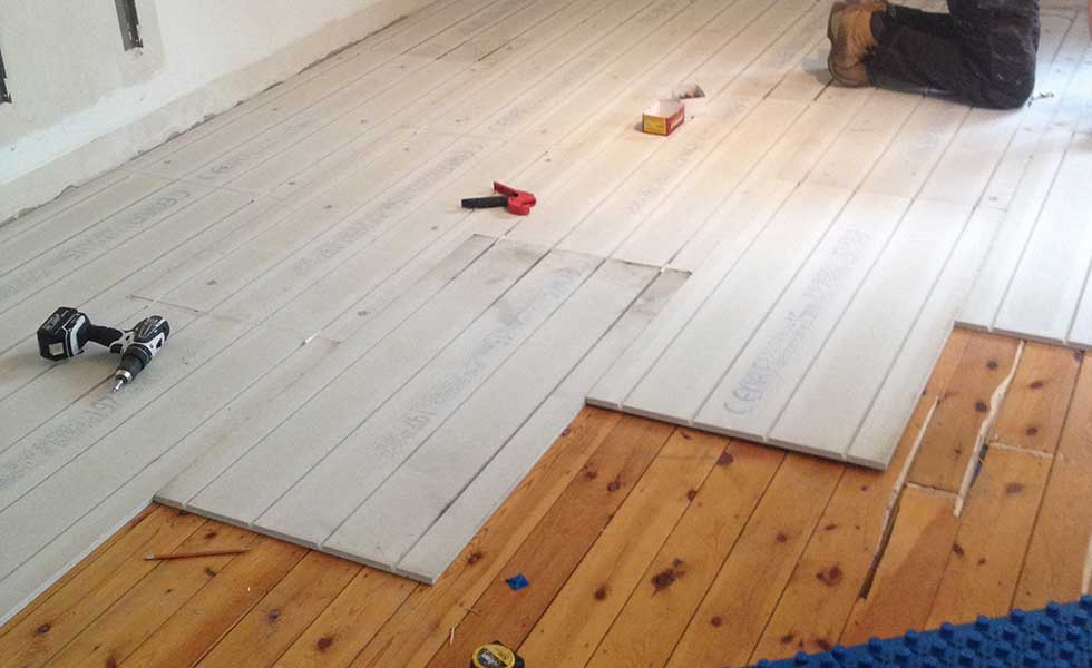 Lo-pro underfloor heating installation over wooden floor