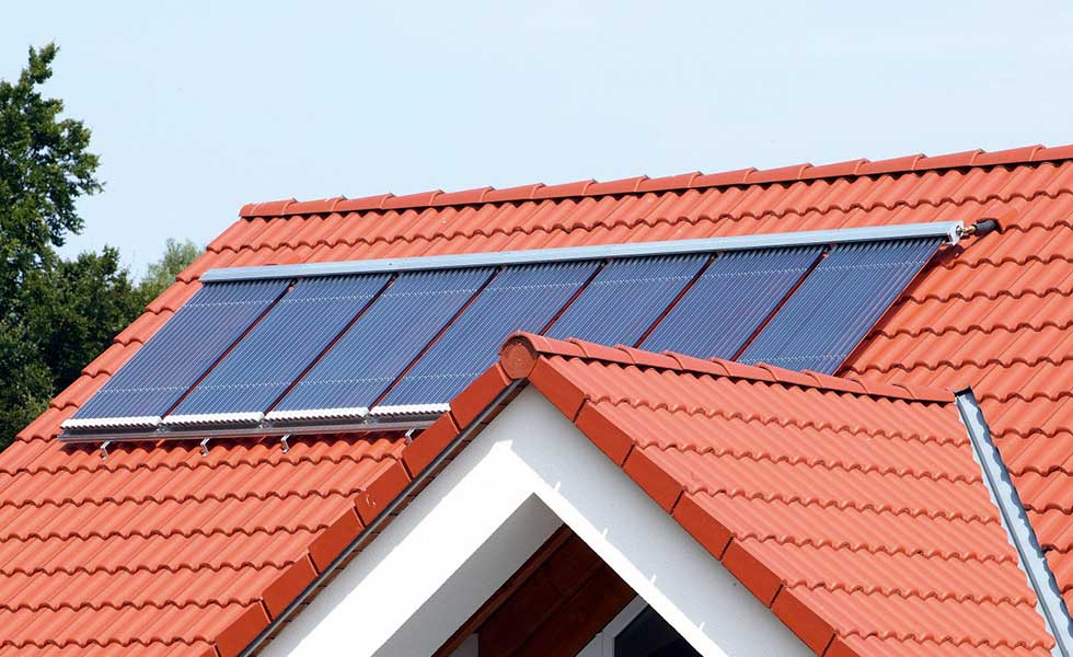solar thermal panels on a red roof