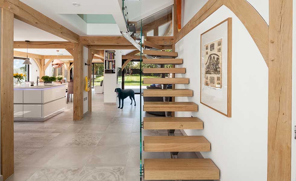 wood and glass staircase in timber frame home
