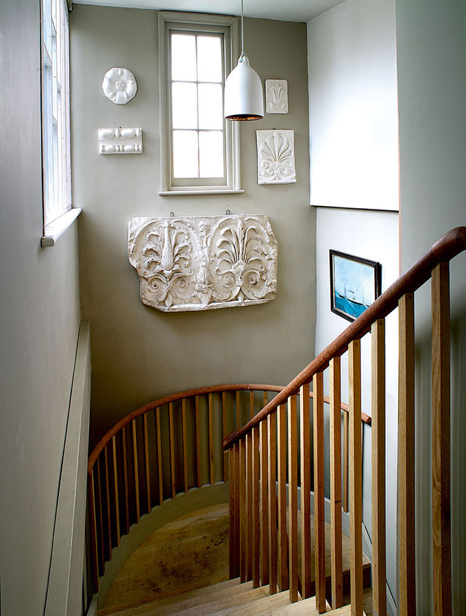 walnut staircase with off-white walls