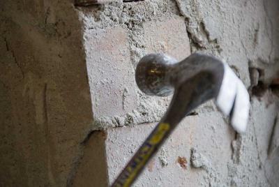 Hammering a brick wall