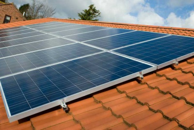 Solar Photovoltaic system on a tiled roof supplied and installed by Geowarmth