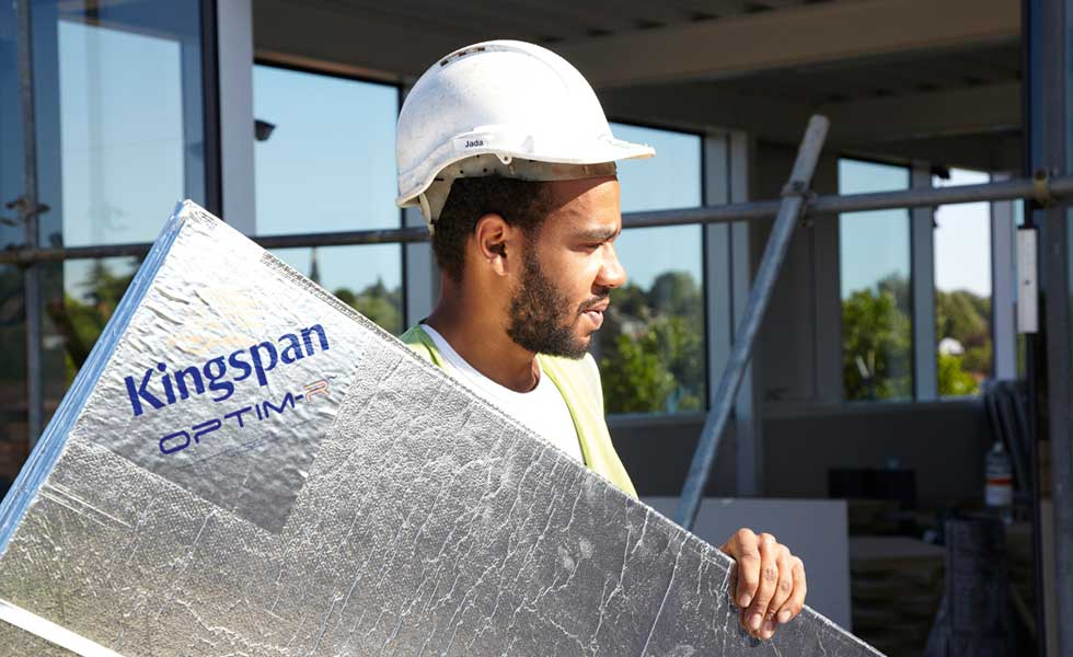 man carrying Kingspan VIP insulation