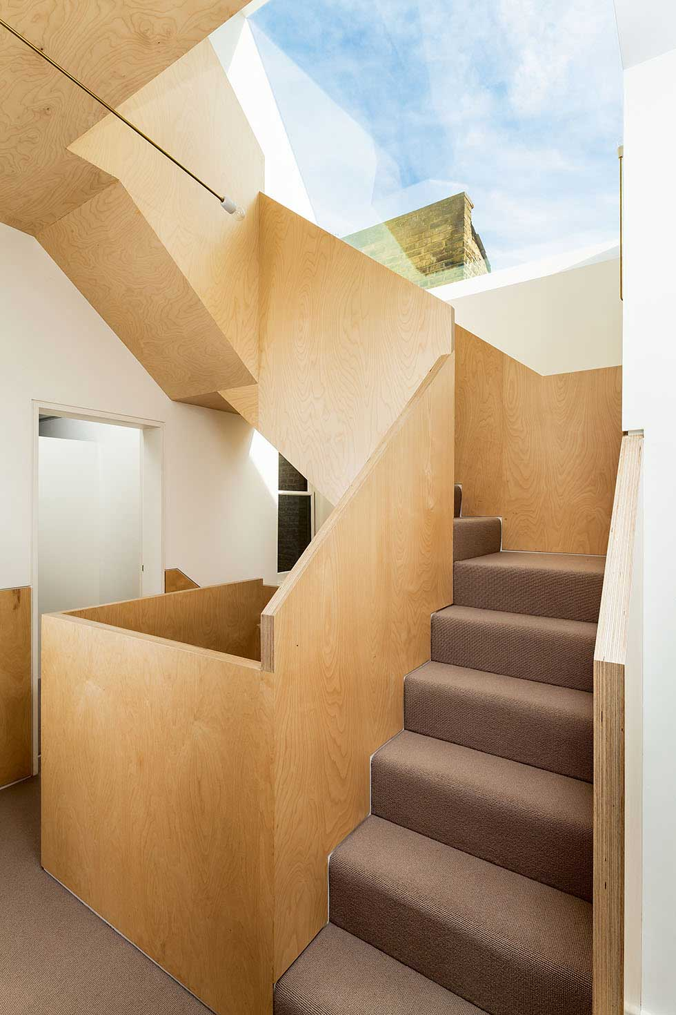 A Dramatic Triple Height Plywood Staircase Creates A Stark Contrast To The  Victorian Exterior Of This Home. The Stairwell Is Crowned By A Large  Skylight ...