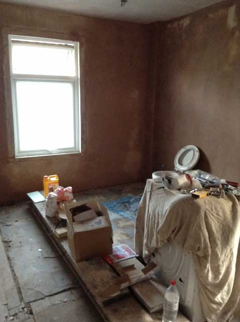 plastering the bedroom which was a bathroom