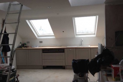 two skylights in a kitchen in a loft conversion