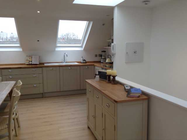 kitchen diner with skylight and wooden worktops
