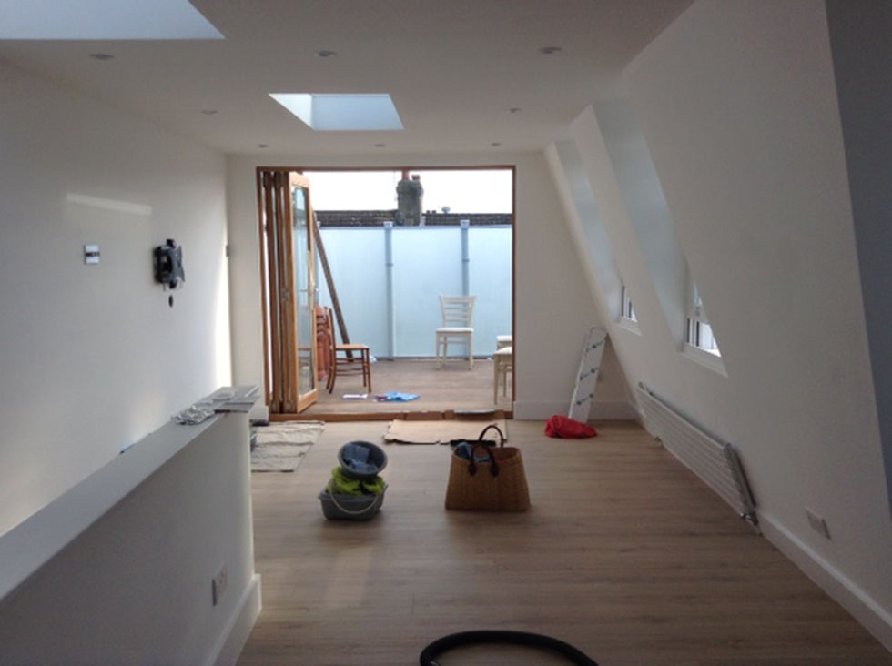 loft conversion living space painted white open plan