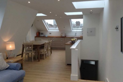 mansard loft conversion open plan living space kitchen diner