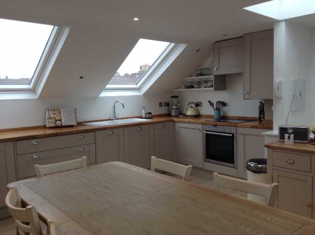 kitchen in loft conversion with mushroom grey cabinets