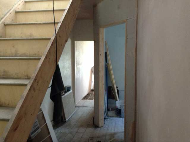 reconfigured hallway with wooden staircase