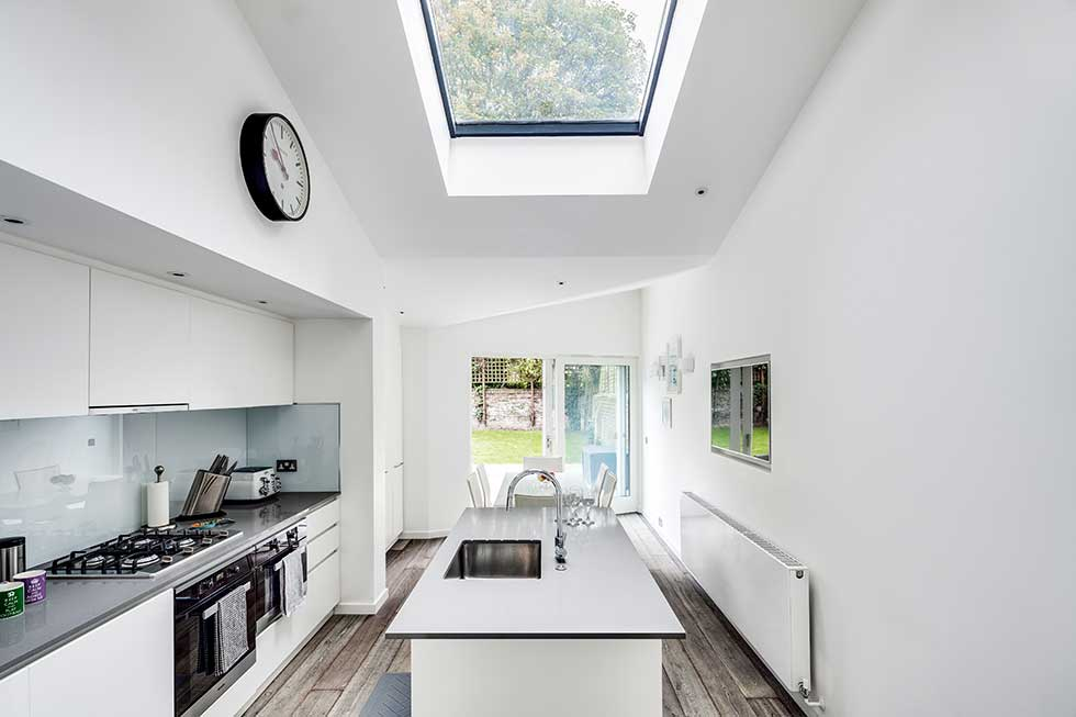 White modern kitchen with rooflight